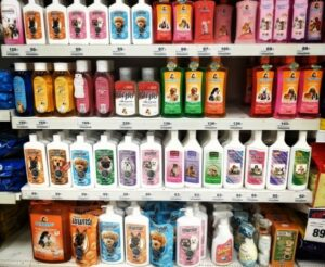 Displayed in a store many colorful dog shampoos and grooming products on a shelf