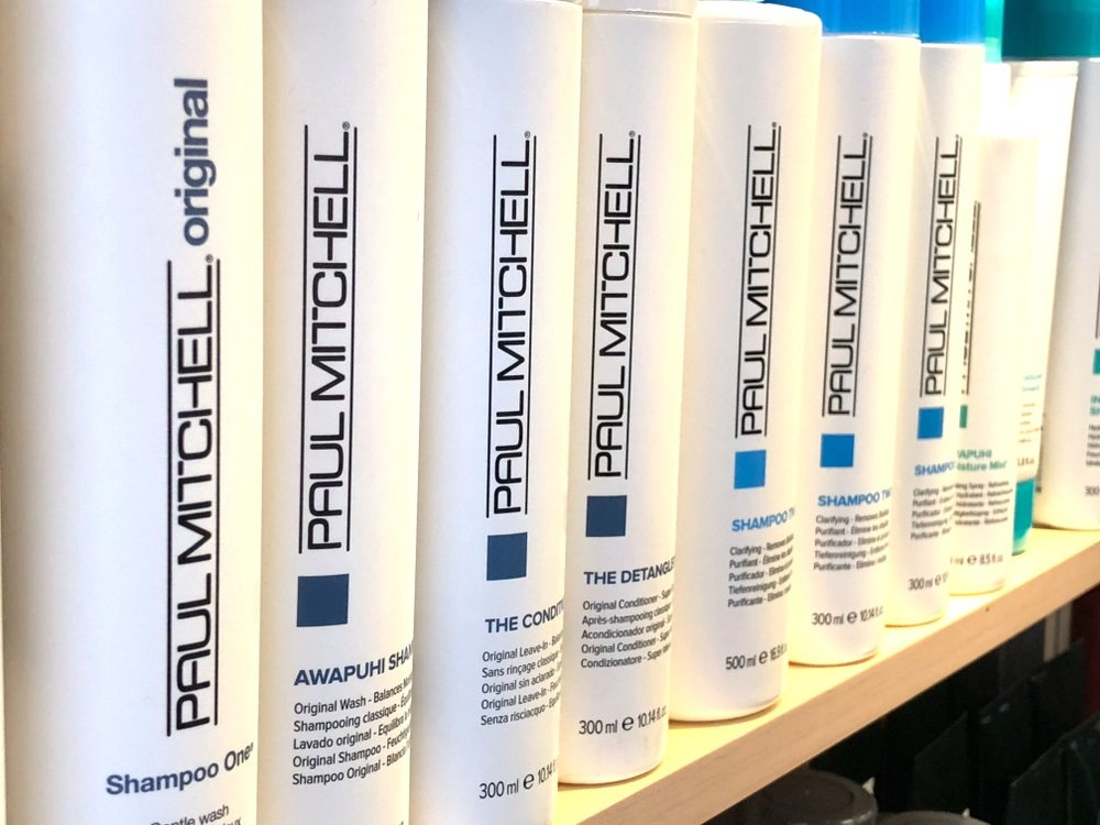 Multiple Paul Mitchell shampoos for pets on a store shelf